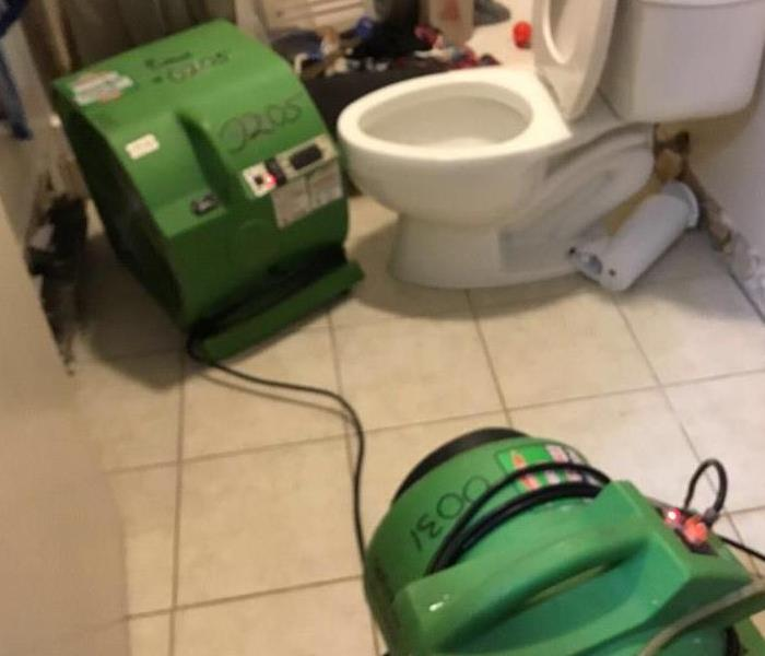 Water cleanup in bathroom after plumbing failure