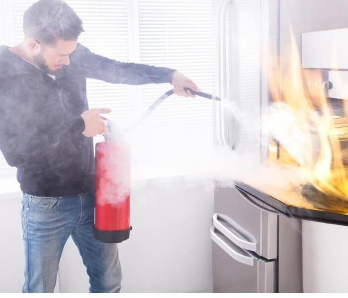 man holding fire extingisher