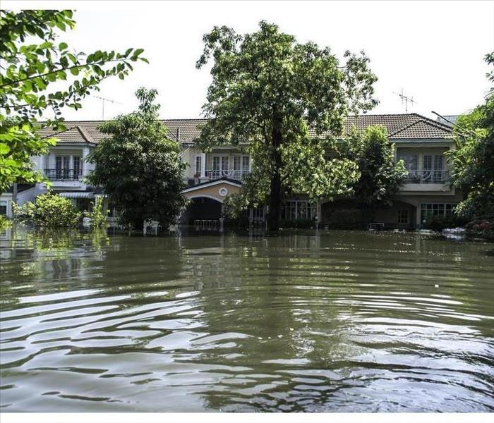 A house surrounded by flooded water
